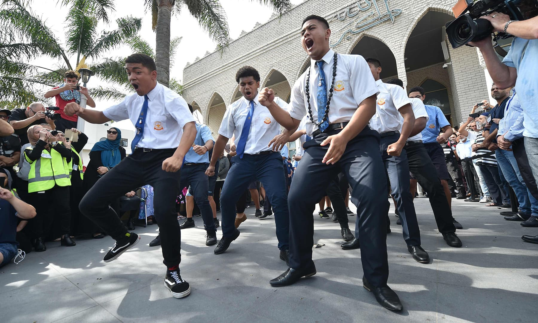 Maori schoolboys perform a Haka after Friday prayers at Lakemba Mosque in Sydney on March 22, one week after the mass shooting attacks at two mosques in Christchurch. — AFP
