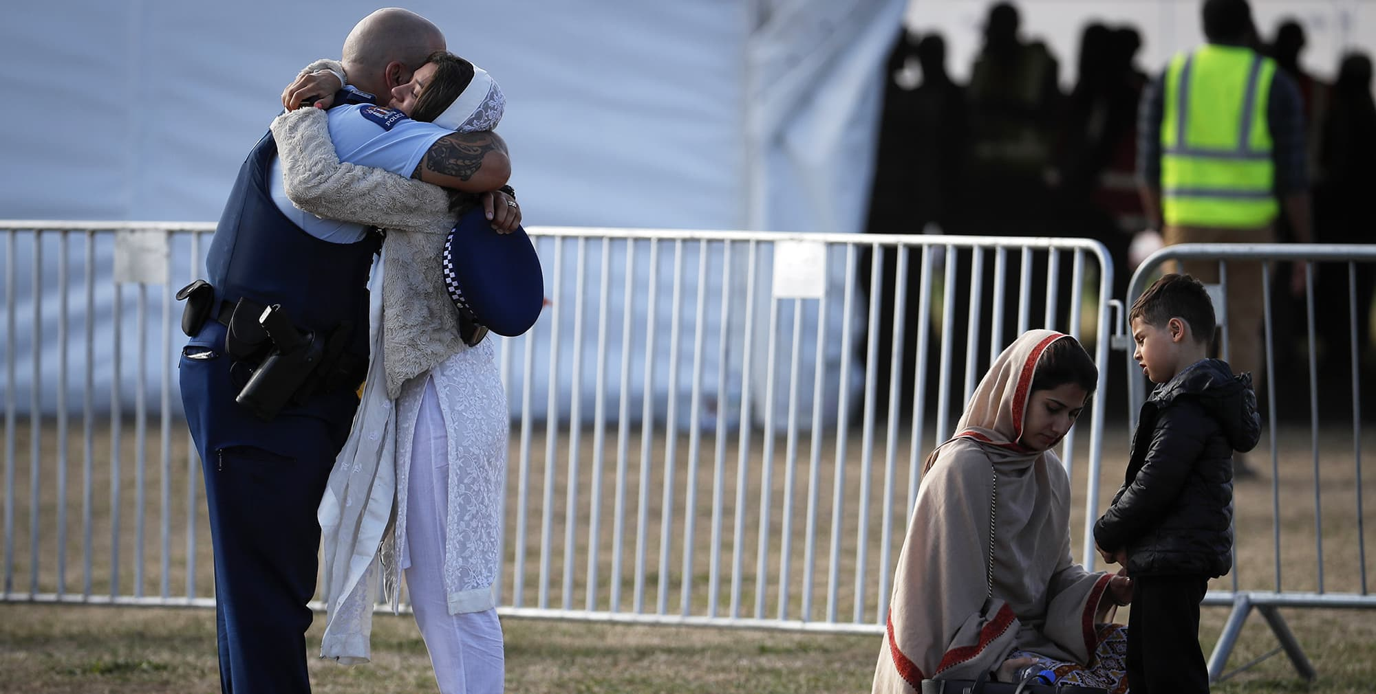 A police official hugs a relative after the burial of a victim in the mass shootings last week at the Memorial Park Cemetery in Christchurch, New Zealand, Friday, March 22, 2019. (AP Photo/Vincent Thian) — Copyright 2019 The Associated Press. All rights reserved