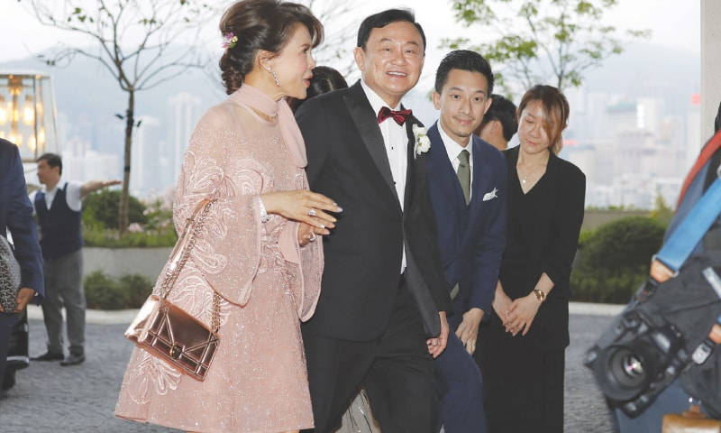 Hong Kong: Former Thailand prime minister Thaksin Shinawatra (centre) accompanies Princess Ubolratana after she arrived at a hotel on Friday for the wedding of Thaksin's youngest daughter.—AP