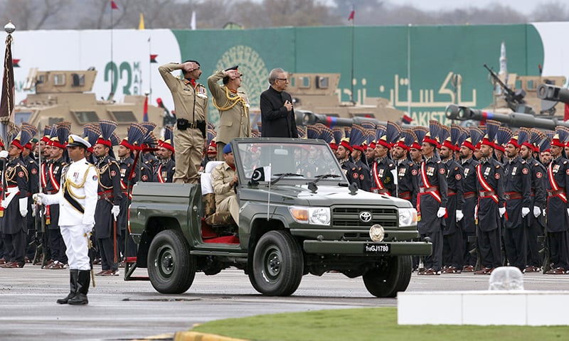 President Arif Alvi on a military vehicle reviews a military parade to mark Pakistan Day in Islamabad on Saturday, March 23, 2019. — AP