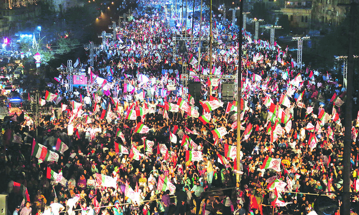 MQM-P supporters throng the Liaquatabad flyover during a protest in Karachi | Shakil Adil, White Star