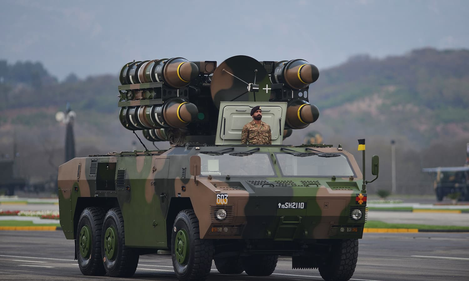 A soldier stands beside an Air Defence Systems during the Pakistan Day parade. ─ AFP
