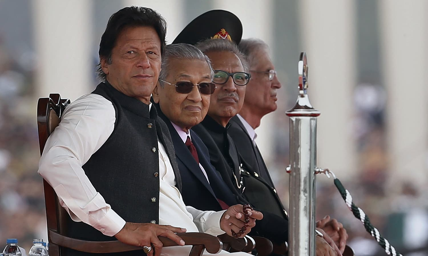 From left: Prime Minister Imran Khan, Malaysian Prime Minister Mahatir Mohamad, and President Arif Alvi attend the Pakistan Day military parade in Islamabad on March 23, 2019. ─ AP