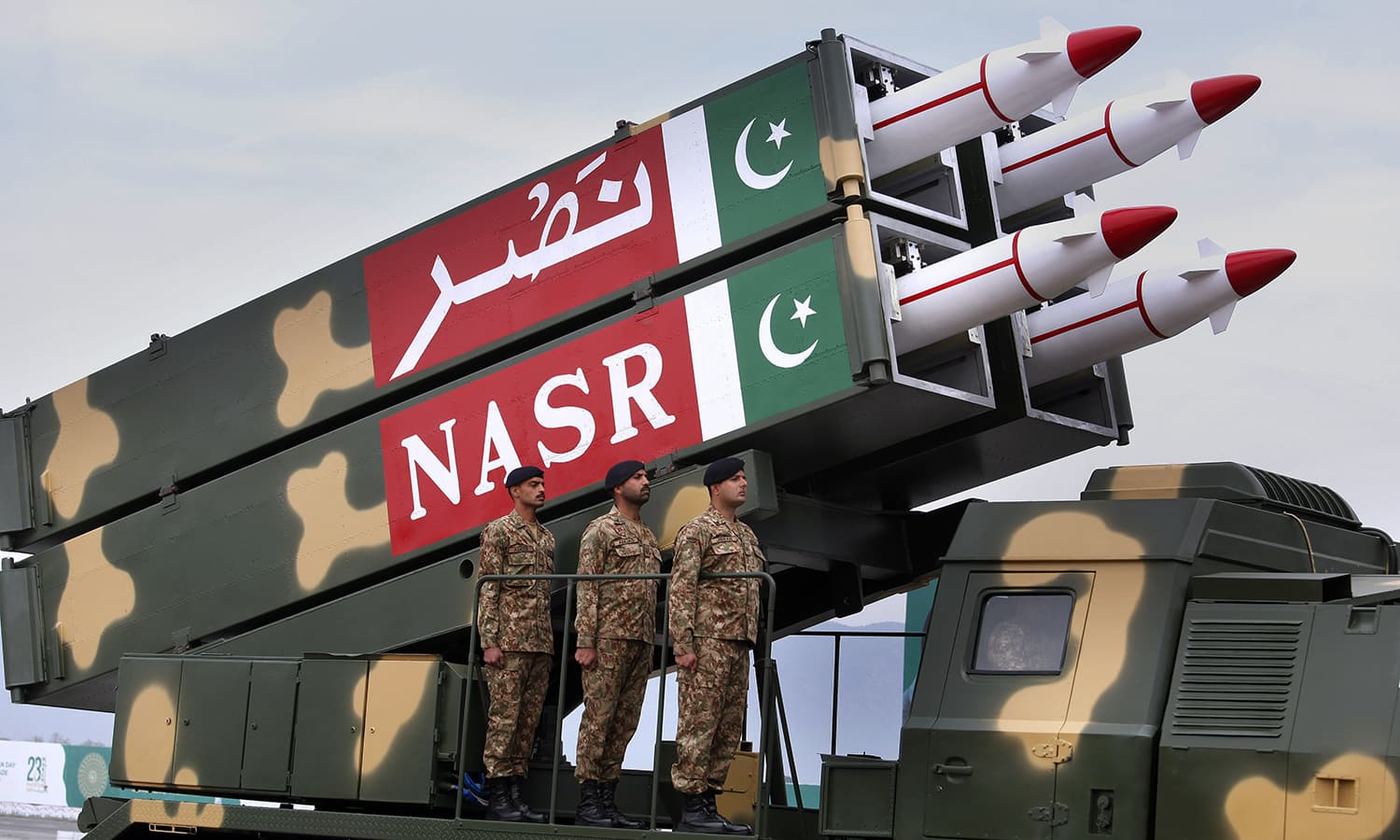Pakistani-made ballistic missile Nasr rolls down during the military parade. ─ AP