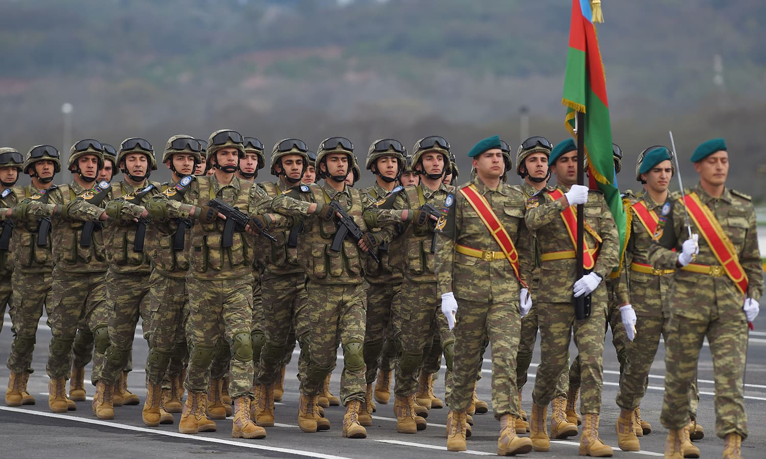 Visiting Azerbaijani troops march during the Pakistan Day parade in Islamabad. ─ AFP