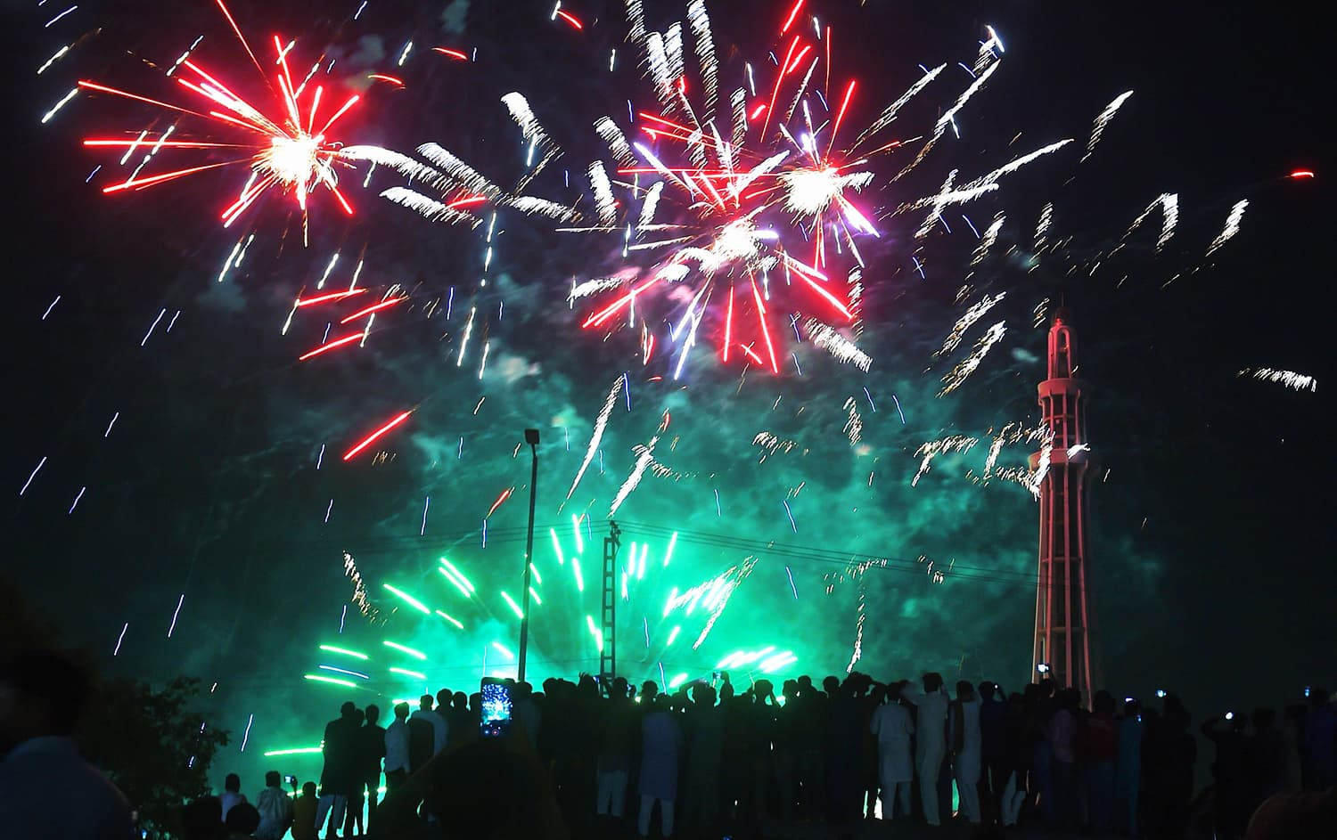 As the clock strikes midnight on March 23, 2019, people set off fireworks to celebrate Pakistan Day. ─ AFP