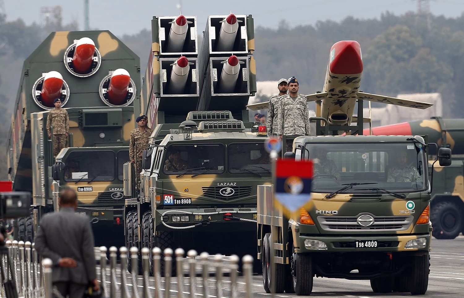 Pakistan-made missiles loaded on a trailers roll down during the military parade. ─ AP
