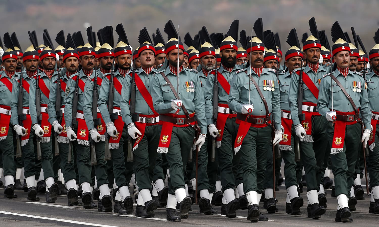 Paramilitary troops march during the military parade. ─ AP