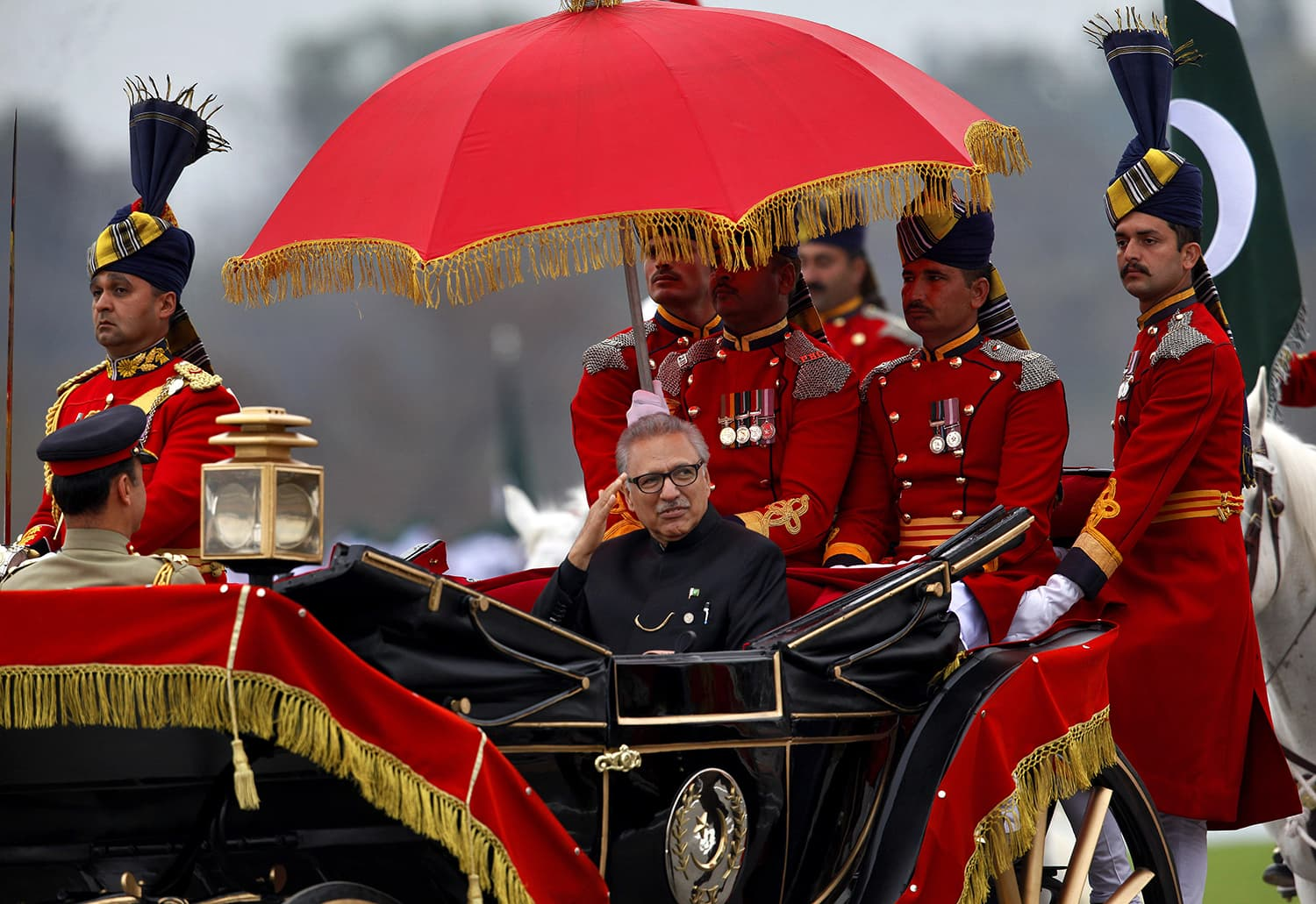 President Arif Alvi salutes as he arrives to attend the Pakistan Day military parade in Islamabad. ─ AP