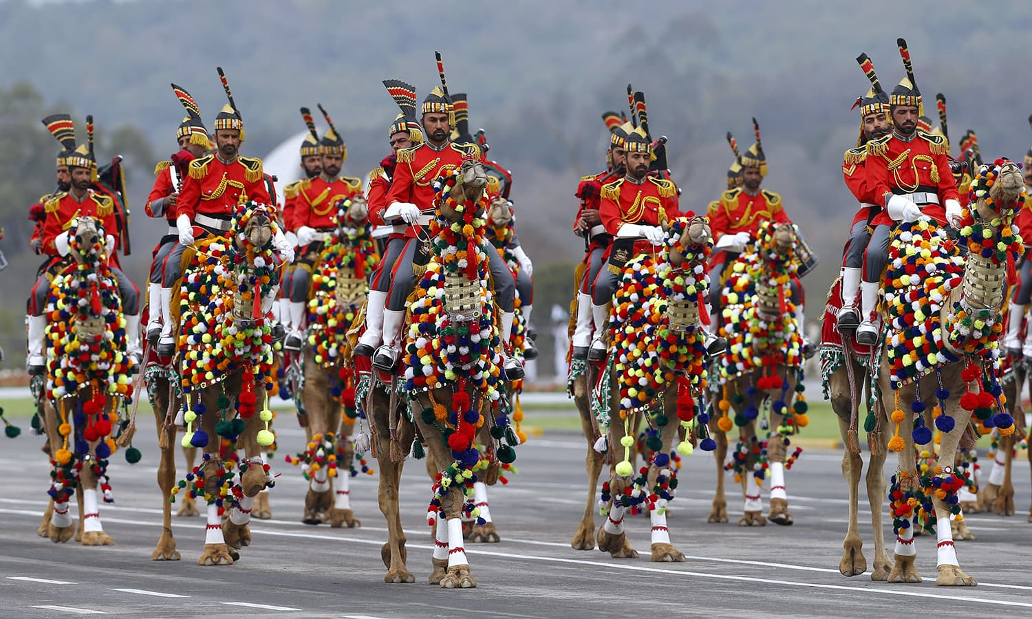 The Pakistan Army musical band on camelback during a military parade to mark Pakistan Day. ─ AP