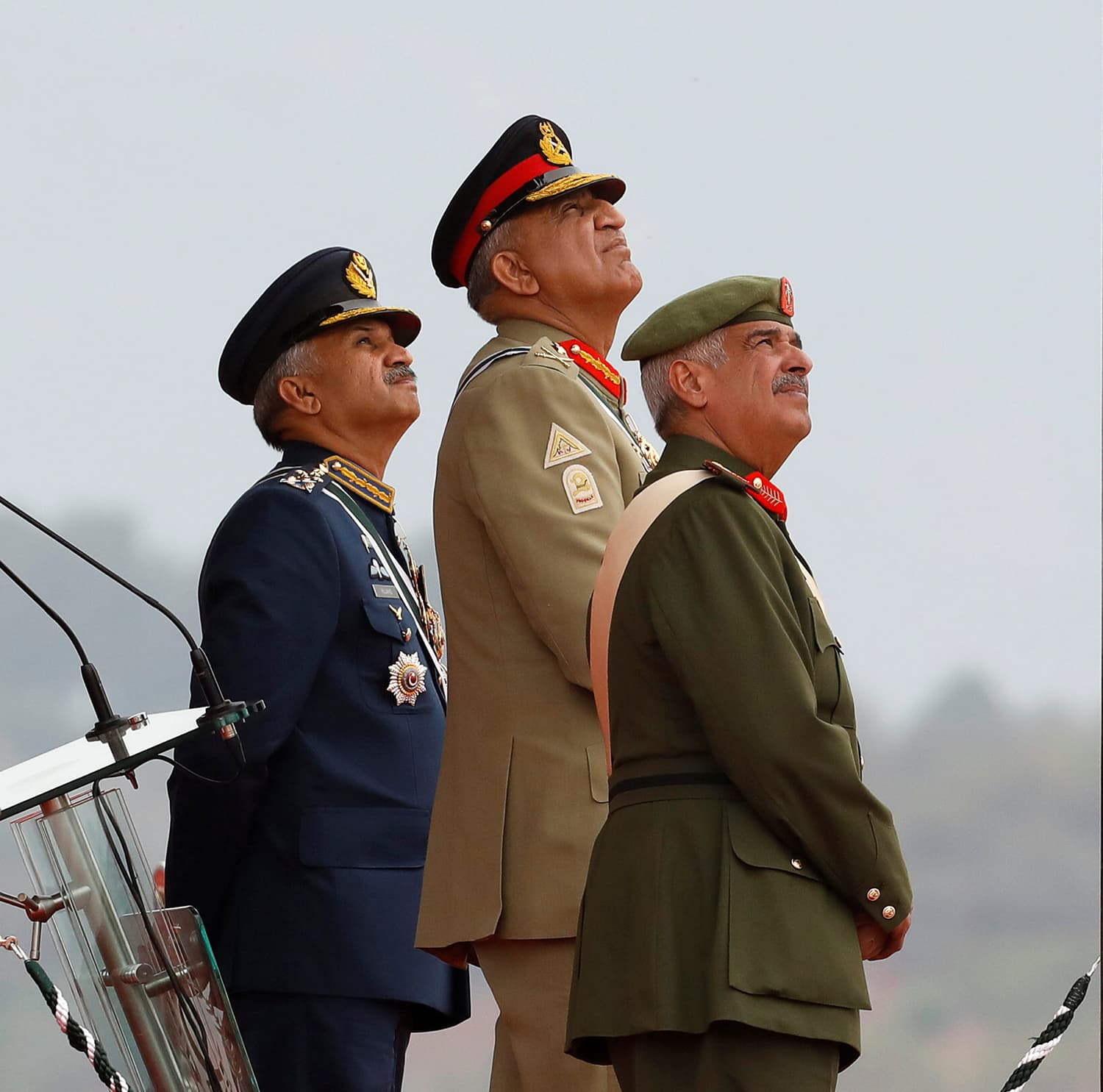 Chief of Army Staff Gen Qamar Javed Bajwa (C) along with Commander of the National Guard of the Kingdom of Bahrain Lieutenant-General Sheikh Mohammed bin Isa bin Salman Al Khalifa and Air Chief Marshal Mujahid Anwar Khan observe the fly-past by Pakistan Air Force JF-17 Thunder fighter jets during the Pakistan Day military parade in Islamabad. ─ Reuters