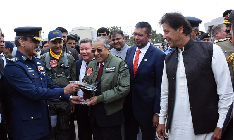 Malaysian PM Dr Mahathir interacts with PAF officers as Prime Minister Khan looks on. — PID