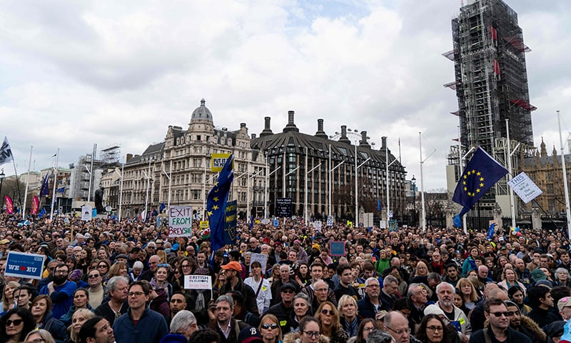 Crowds gather after the march to listen to speakers at a rally organised by the pro-European People's Vote campaign for a second EU referendum in Parliament Square, central London. ─ AFP