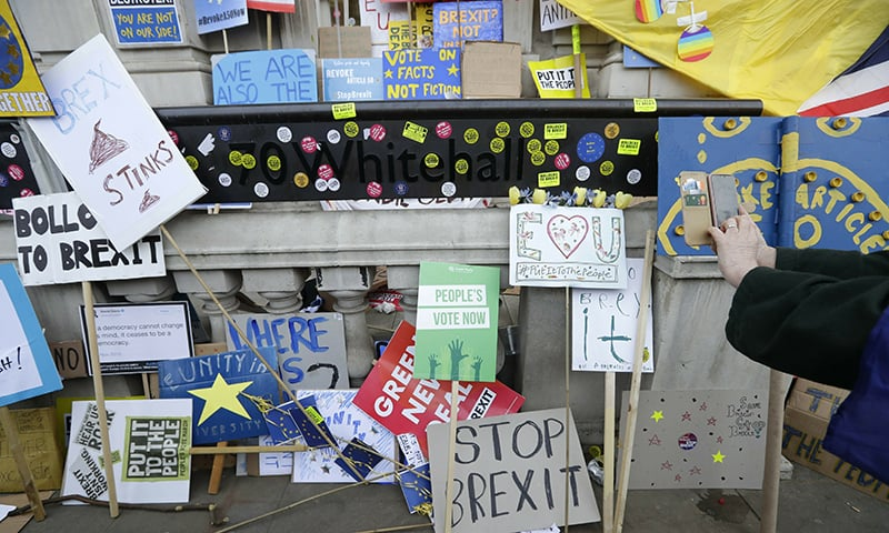 Placards and banners are placed outside the cabinet offices during a Peoples Vote anti-Brexit march in London. ─ AP