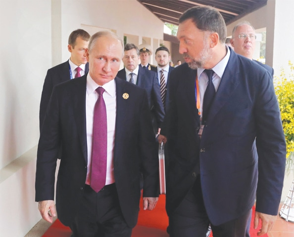 IN this file photo, Russia's President Vladimir Putin and Russian metals magnate Oleg Deripaska walking to attend the APEC Business Advisory Council dialogue in Danang, Vietnam.—AP