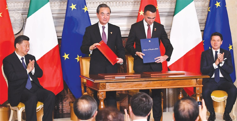 ROME: (From L) China's President Xi Jinping, China's Foreign Minister Wang Yi, Italy's Labour and Industry Minister and deputy PM Luigi Di Maio and Italy's Prime Minister Giuseppe Conte attend a signing ceremony at Villa Madama on Saturday.—AFP