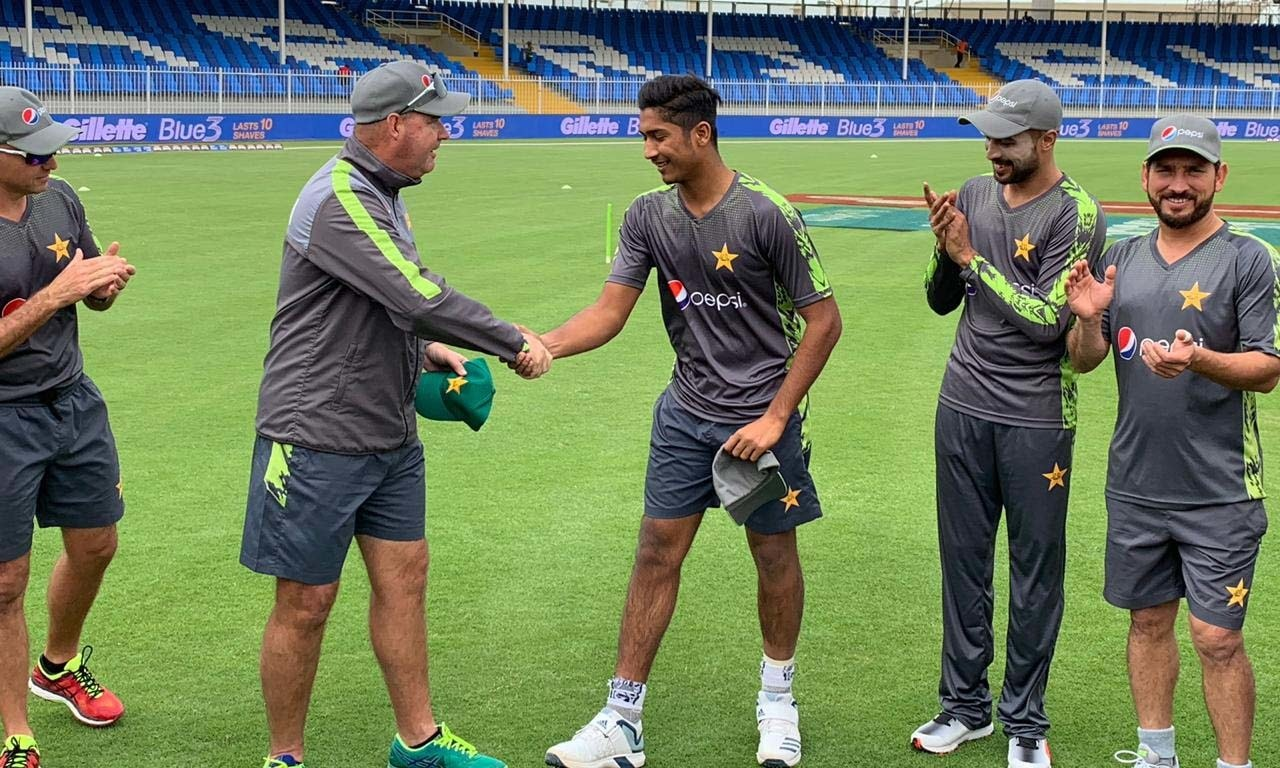Debutant Muhammad Hasnain gets his ODI cap from the head coach Mickey Arthur. — PCB's Twitter