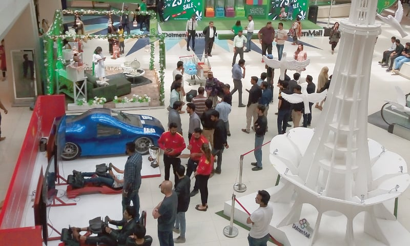 THE students-built car at the shopping mall on Sunday.—Photo by writer