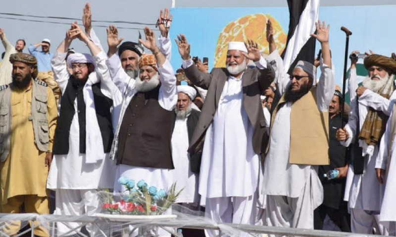 Maulana Fazlur Rehman waves to supporters during a rally in Mirali, North Waziristan, on Sunday. — Dawn