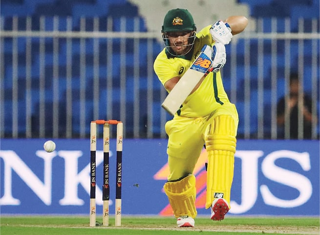 AUSTRALIAN captain Aaron Finch drives the ball during his scintillating knock on Sunday.—AFP