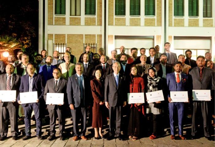 Recipients of the MEXT scholarships pose with Japanese Ambassador Kuninori Matsuda at the reception in Islamabad.