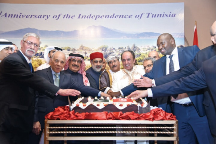 Ambassador Adel Elarbi, Federal Minister for National Food Security and Research Mehboob Sultan and other dignitaries cut the ceremonial cake on the occasion of the 63rd Tunisian Independence Day in Islamabad.