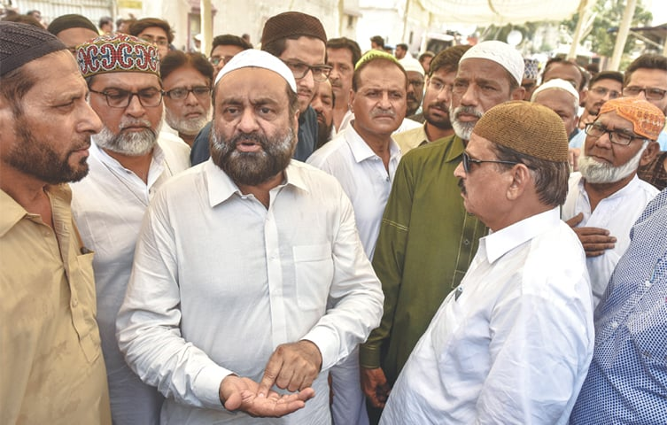 PEOPLE condole with Ijaz Ahmed (centre), father of young Areeb on Monday.—Fahim Siddiqi / White Star