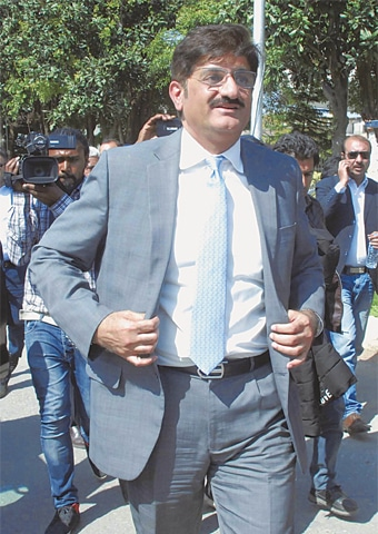 SYED Murad Ali Shah leaves the NAB office after his appearance in fake accounts case on Monday.—Online