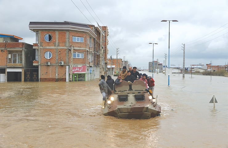 TEHRAN: Military vehicles rescue people after flash flooding around the northern Iranian city of Aq Qala, in Golestan province.—AP
