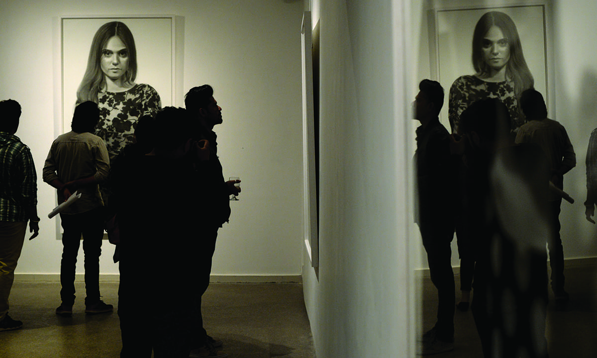 Visitors at the *Larger than Life* exhibition at Canvas Gallery | Arif Mahmood, White Star