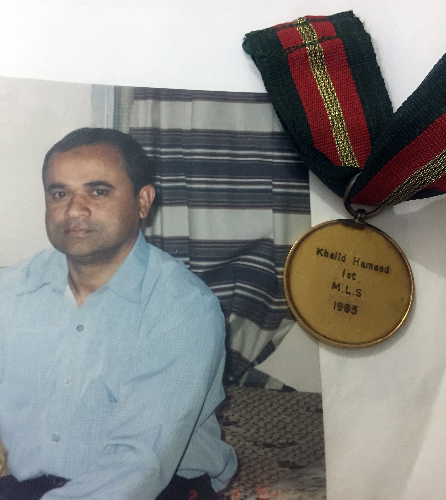 An old photo of Professor Hameed  and his gold medal in Library Sciences