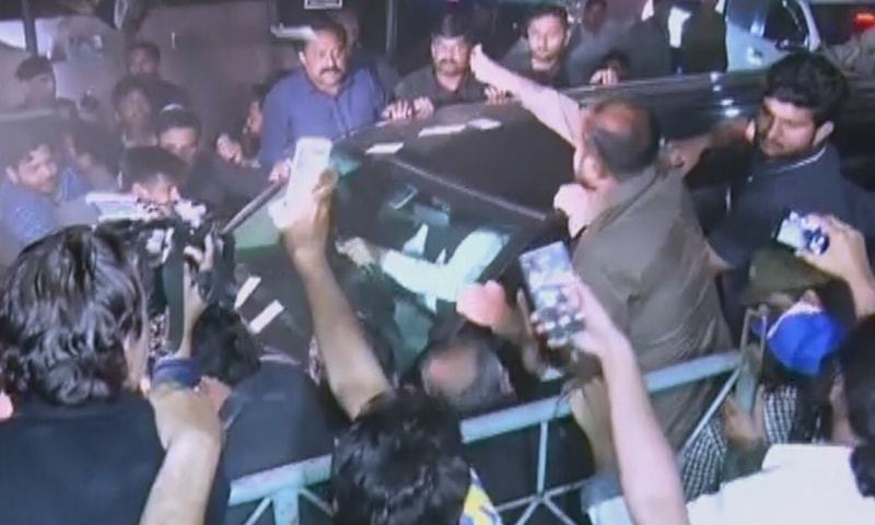 Supporters surround the vehicle carrying Nawaz Sharif outside Kot Lakhpat jail in Lahore.  — DawnNewsTV