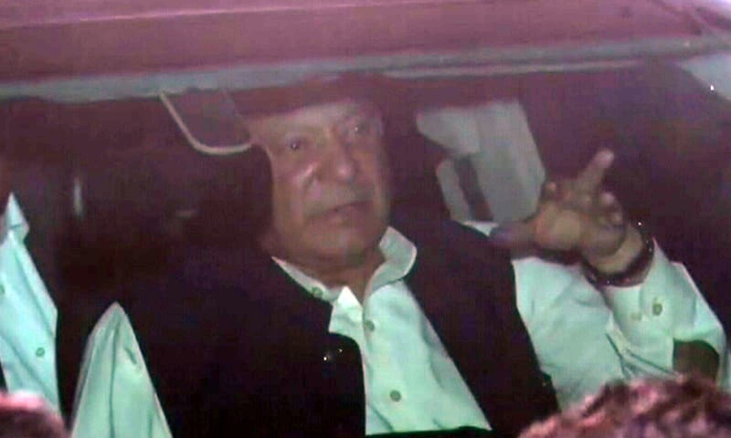 Nawaz Sharif gestures from his car after his release from jail. — DawnNewsTV