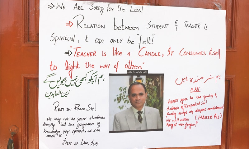 AS a sign of respect, students of SE college wrote messages of love on the door of the office where Professor Khalid Hameed was stabbed to death.—Photo by writer