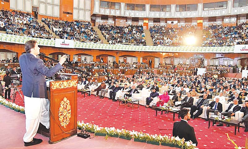 ISLAMABAD: Prime Minister Imran Khan addressing the ceremony held on Wednesday to launch the Poverty Alleviation Programme 'Ehsaas'.—APP