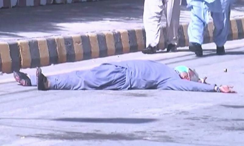 An injured protestor is seen lying on the road. —DawnNewsTV