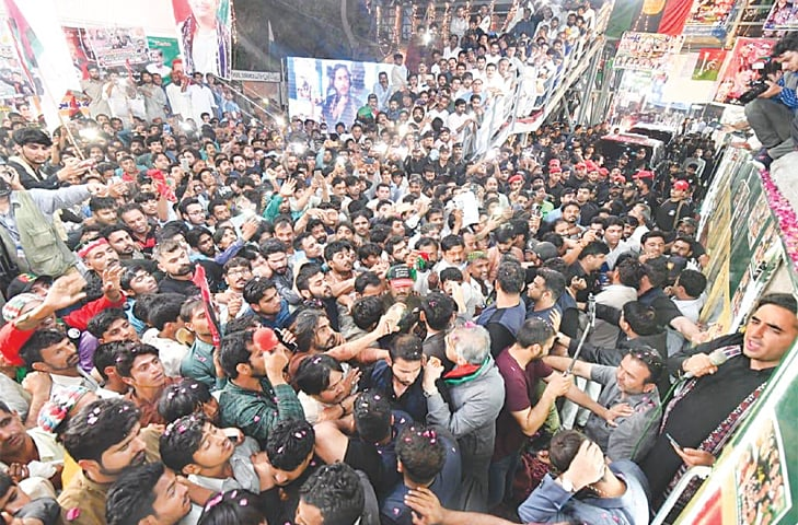 BILAWAL Bhutto-Zardari speaks to his supporters at the Larkana railway station on Thursday morning.—Dawn