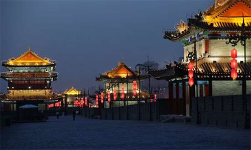 Lanterns and flags decorate the old city wall of Xi'an, Shaanxi province, China. Xi'an, Urumqi and Puyang have been named as the sister cities of Multan, Karachi and Gwadar respectively. — Photo courtesy: Encyclopedia Britannica