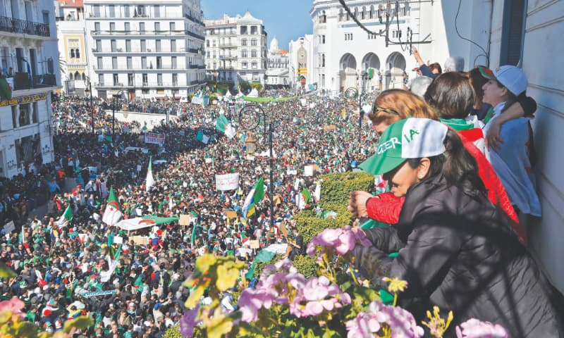 Thousands march against Algeria's president