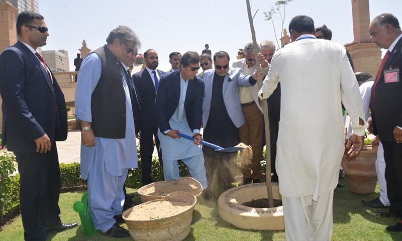 Prime Minister Imran Khan plants a sapling at Bagh Ibne Qasim. — Photo courtesy: Imtiaz Ali