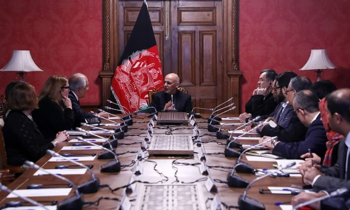 Afghan President Ashraf Ghani at a meeting with the United States special envoy, Zalmay Khalilzad, in Kabul | AFP