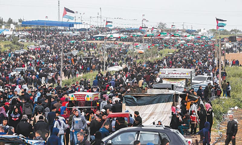 PALESTINIANS gather for a massive demonstration near the Gaza-Israel border on Saturday as they mark the first anniversary of 'March of Return' protests.—AFP