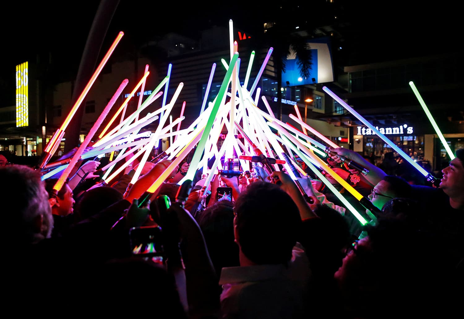 Star Wars enthusiasts huddle with their lightsabers after participating in Earth Hour at Taguig City, Philippines on March 30, 2019. ─ Reuters