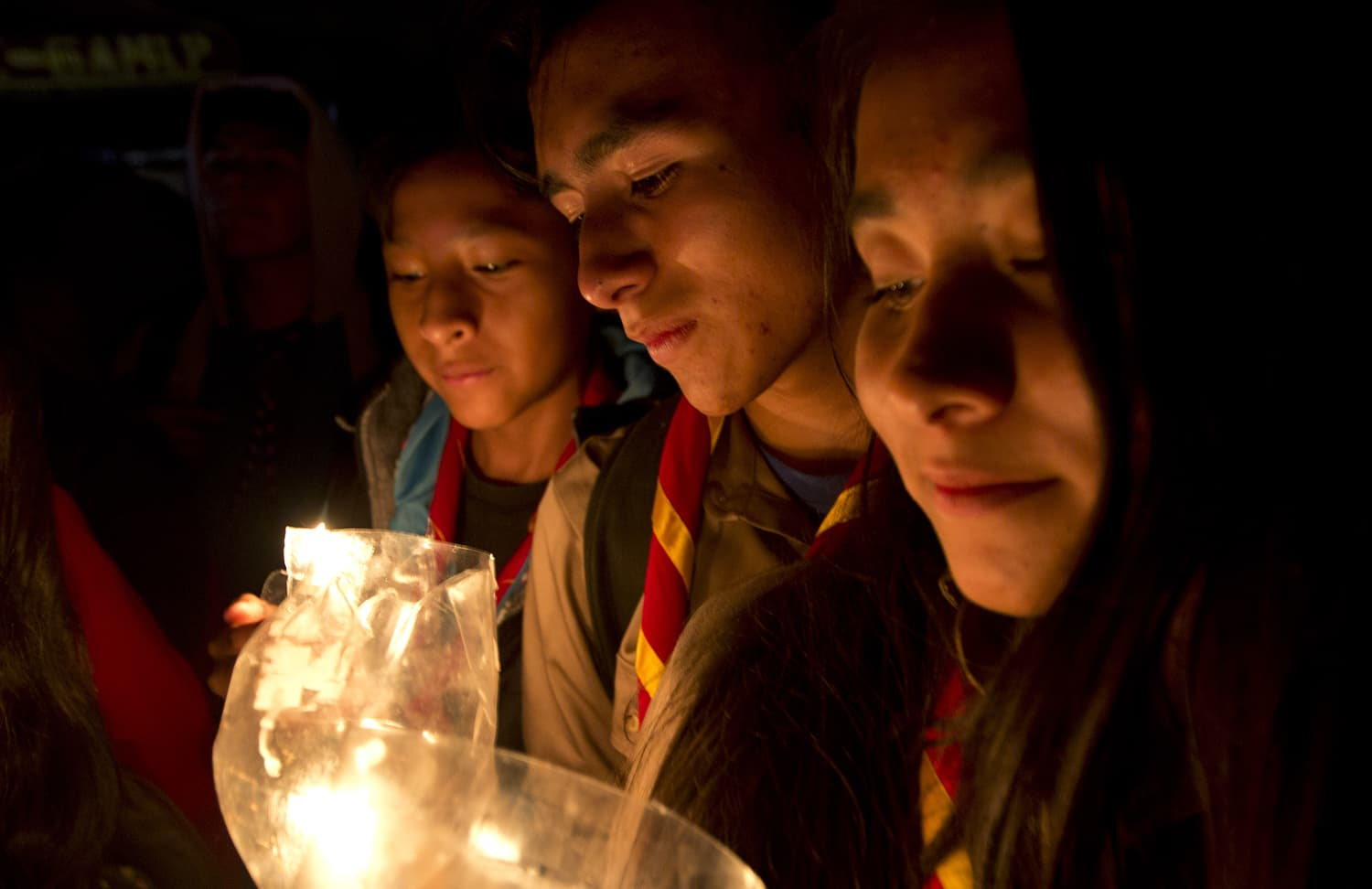 People take part in a candlelight vigil marking Earth Hour in La Paz, Bolivia. ─ AP