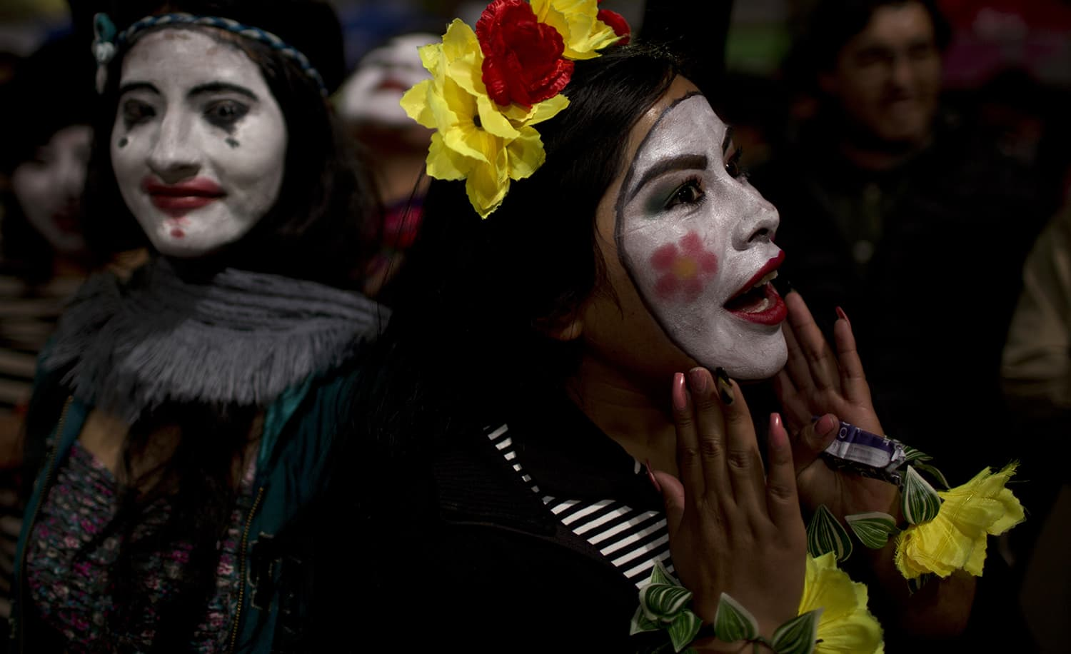 Mimes take part in a candlelight vigil marking Earth Hour in La Paz, Bolivia. ─ AP