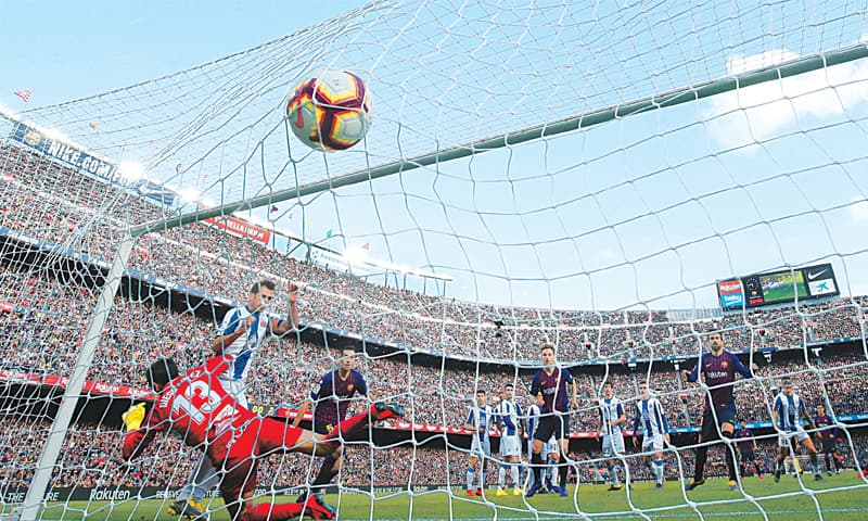 Back with Barcelona, Messi thrives in latest Liga win