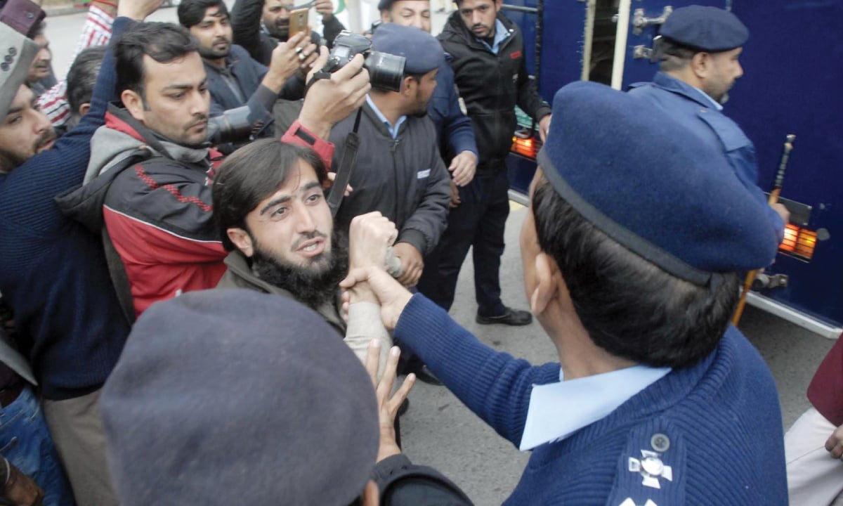 Police personnel arrest a Pashtun Tahafuz Movement activist during a protest outside the National Press Club in Islamabad | Online