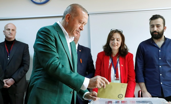 Turkish President Tayyip Erdogan casts his ballot at a polling station during the municipal elections. ─ Reuters