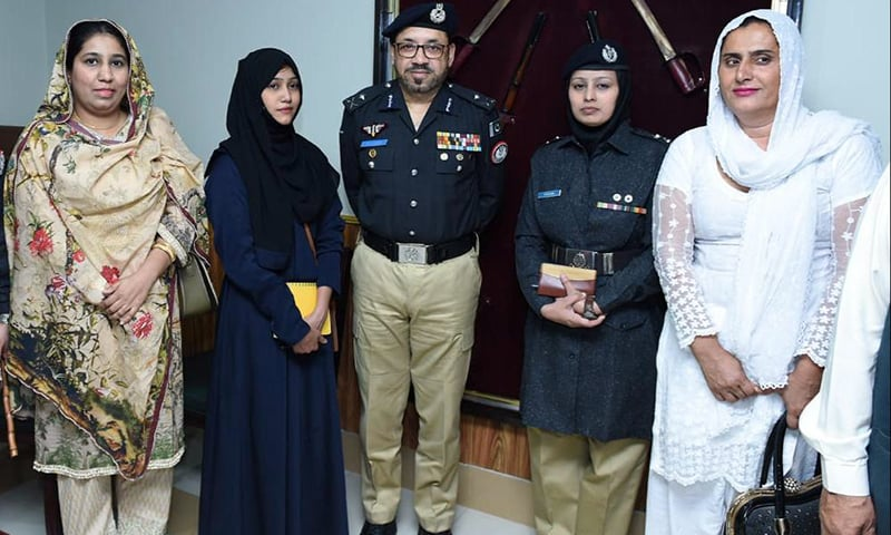 Sindh Inspector General Dr Syed Kaleem Imam in a group photo with a representative of the transgender community (in white) and others. — Photo courtesy Sindh police