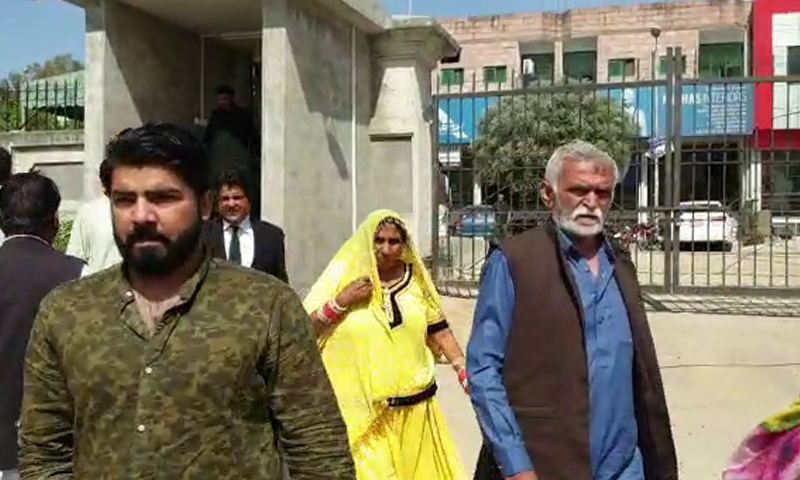 The two girls' family members outside the Islamabad High Court on Tuesday. — DawnNewsTV